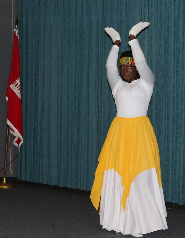 Josephine-Joy Hammond dances during the African American Heritage program at the Tulsa District office, Feb. 15. Hammond, who is a native of Ghana, a nation located in West Africa, performs and teaches praise and contemporary interpretive dance at her church.