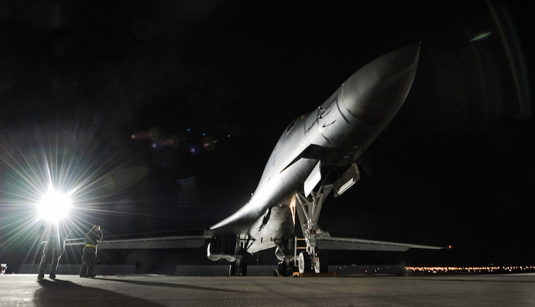 A B-1B Lancer assigned to the 34th Bomb Squadron, Ellsworth Air Force Base, S.D., rests on the flightline as maintainers perform preflight checks during night operations of Red Flag 17-1 on Nellis Air Force Base, Jan. 25, 2017. Flying units from around the globe deploy to Nellis AFB to participate in Red Flag. (U.S. Air Force photo by Airman 1st Class Kevin Tanenbaum/Released)