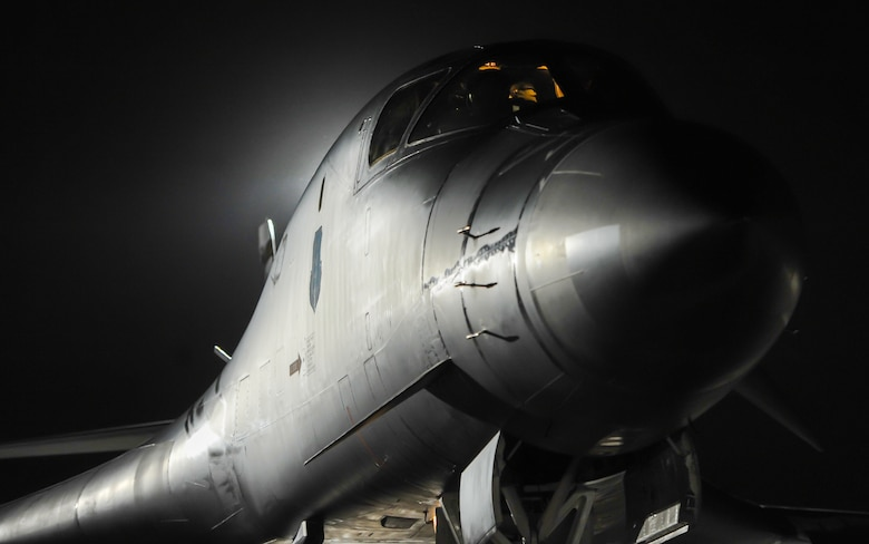A B-1B Lancer assigned to the 34th Bomber Squadron, Ellsworth Air Force Base, S.D., rests on the flightline as pilots perform preflight checks during Red Flag 17-1 on Nellis Air Force Base, Nev., Jan. 25, 2017. Red Flag night missions present the additional challenge of low visibility, testing aircrew's ability to execute the mission at any hour in a contested and degraded environment. (U.S. Air Force photo by Airman 1st Class Kevin Tanenbaum/Released)
