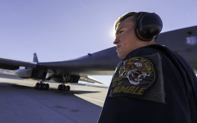 Senior Airman Jacob Widtmannheiser, a crew chief assigned to the 28th Aircraft Maintenance Squadron, Ellsworth Air Force Base, S.D., prepares a B-1B Lancer for take-off during Red Flag 17-1 on Nellis Air Force Base, Nev., Jan. 27, 2017. Red Flag is one of a series of advanced training programs administered by the U.S. Air Force Warfare Center to train aircrews. (U.S. Air Force photo by Airman 1st Class Kevin Tanenbaum/Released)