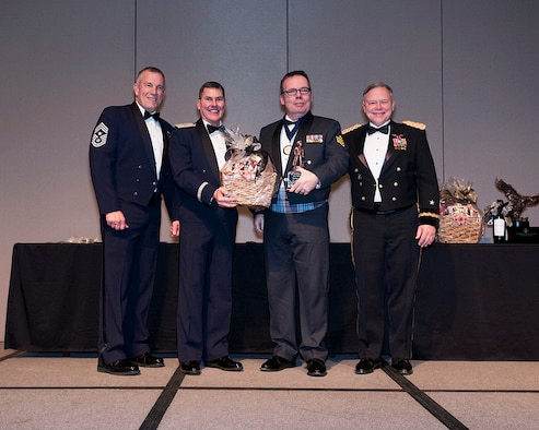 Royal Canadian Air Force Sgt. Yves Truchon of the 225th Air Defense Squadron wins the Honor Guard Member of the Year award at the Washington Air National Guard 8th Annual Awards Banquet.  Pictured from right to left are: Maj. Gen. Brett Daugherty, The Adjutant General, Washington; RCAF Sgt. Yves Truchon; Brig. Gen. John Tuohy, the Assistant Adjutant General - Air, Washington; and Chief Master Sgt. Max Tidwell, WA ANG Command Chief. (U.S. Air Force photo by Tech. Sgt. Michael Brown)
