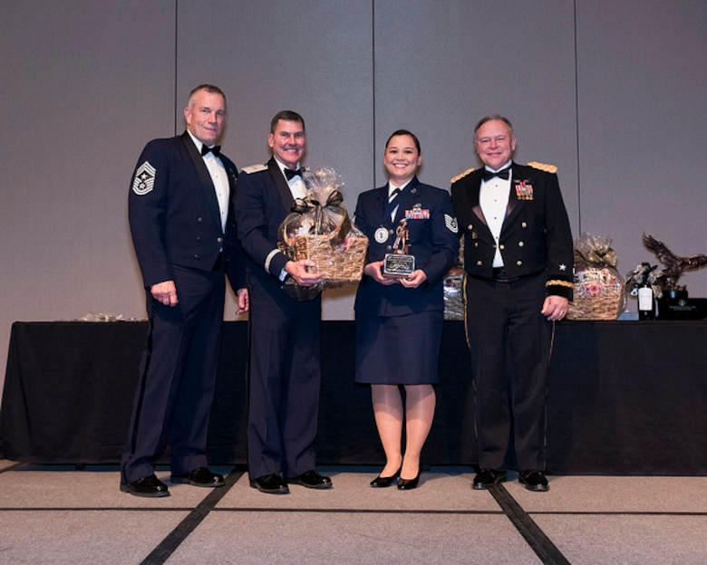 Tech. Sgt. Rivanita Noyes of the 225th Air Defense Squadron wins NCO of the Year during the Washington Air National Guard 8th Annual Awards banquet.  Pictured from right to left are: Maj. Gen. Brett Daugherty, The Adjutant General, Washington; Tech. Sgt. Rivanita Noyes; Brig. Gen. John Tuohy, the Assistant Adjutant General - Air, Washington; and Chief Master Sgt. Max Tidwell, WA ANG Command Chief.  (U.S. Air Force photo by Tech. Sgt. Michael Brown)
