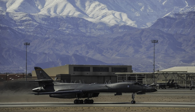 A B-1B Lancer assigned to the 34th Bomb Squadron, Ellsworth Air Force Base, S.D., begins to take off down the runway during Red Flag 17-1 on Nellis Air Force Base, Nev., Jan. 27, 2017. Red Flag involves a variety of attack, fighter, bomber, reconnaissance, electronic warfare, airlift support, and search and rescue aircraft. (U.S. Air Force photo by Airman 1st Class Kevin Tanenbaum/Released)
