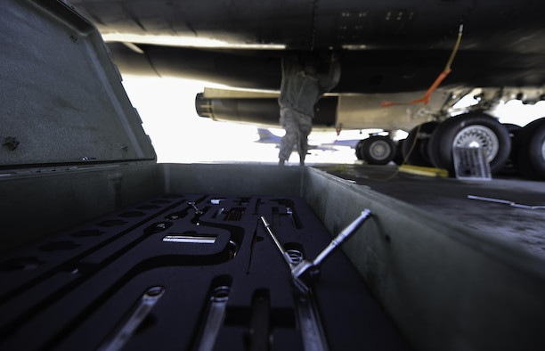 "Airman 1st Class Jaylin King, an aerospace propulsion apprentice assigned to the 28th Aircraft Maintenance Squadron, Ellsworth Air Force Base, S.D., performs maintenance on a grounded B-1B Lancer during Red Flag 17-1 on Nellis Air Force Base, Nev., Jan. 27, 2017. Aircraft and personnel deploy to Nellis AFB for Red Flag under the Air Expeditionary Force concept and make up the exercise's 'Blue"" forces. (U.S. Air Force photo by Airman 1st Class Kevin Tanenbaum/Released)"