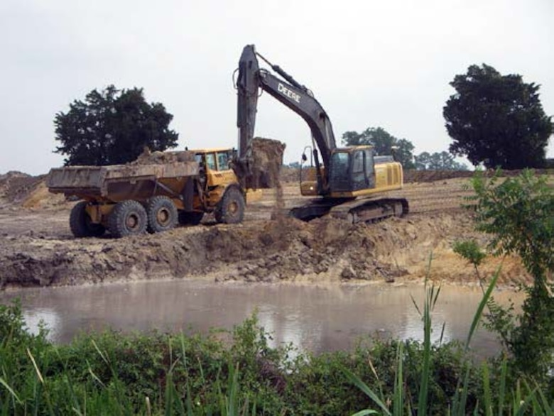 Truck and excavator conducting earthwork