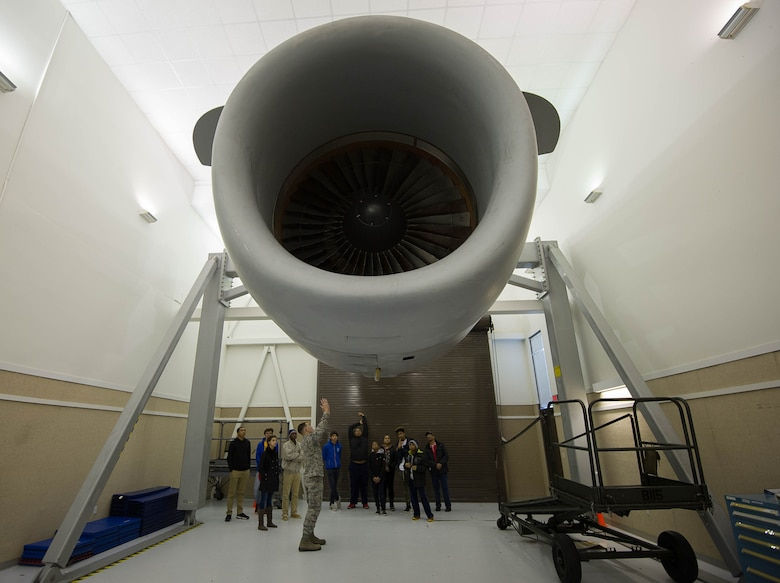 Tech. Sgt. Nathan Gardner discusses a C-17 Globemaster III engine with students from the Red-Tailed Hawks FlyingvFeb. 11, 2017, on Joint Base Lewis-McChord, Wash. Gardener is an instructor with the 373rd Training Squadron, Detachment 12, whose parent unit is located at Sheppard Air Force Base, Witchita Falls, Texas. (U.S. Air Force photo by David L. Yost)