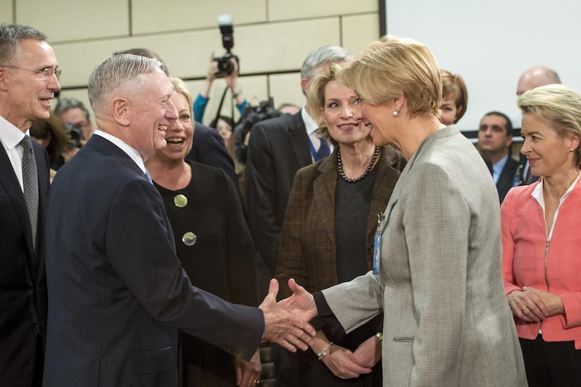 Defense Secretary Jim Mattis exchanges greetings with Italian Defense Minister Roberta Pinotti before a North Atlantic Council meeting at NATO headquarters in Brussels, Feb. 15, 2017. DoD photo by Air Force Tech. Sgt. Brigitte N. Brantley