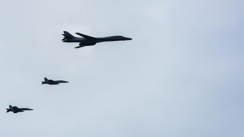 "A B-1B Lancer from Anderson Air Force Base in Guam and two F/A-18E Super Hornets from the ""Golden Dragons"" of Strike Fighter Squadron (VFA) 192 fly over the aircraft carrier USS Carl Vinson (CVN 70) as it transits the Philippine Sea. The B-1s are deployed in support of U.S, Pacific Command's Continuous Bomber Presence mission. In place since 2004, the CBP missions are conducted by U.S. Air Force bombers such as the B-1, B-52 Stratofortress and B-2 Spirit in order to provide non-stop stability and security in the Indo-Asia-Pacific region.  The Carl Vinson Strike Group is on a regularly scheduled Western Pacific deployment as part of the U.S. Pacific Feet-led initiative to extend the command and control functions of U.S. 3rd Fleet. U.S. Navy aircraft carrier strike groups have patrolled the Indo-Asia-Pacific regularly and routinely for more than 70 years. (U.S. Navy Photo by Seaman Jake Cannady)"