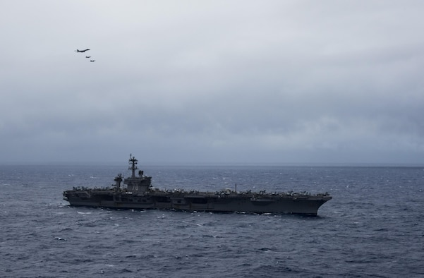 A B-1B Lancer from Anderson Air Force Base in Guam flies over the aircraft carrier USS Carl Vinson (CVN 70) as it transits the Philippine Sea.  The B-1s are deployed in support of U.S, Pacific Command's Continuous Bomber Presence mission. In place since 2004, the CBP missions are conducted by U.S. Air Force bombers such as the B-1, B-52 Stratofortress and B-2 Spirit in order to provide non-stop stability and security in the Indo-Asia-Pacific region. The Carl Vinson Strike Group is on a regularly scheduled Western Pacific deployment as part of the U.S. Pacific Feet-led initiative to extend the command and control functions of U.S. 3rd Fleet. U.S. Navy aircraft carrier strike groups have patrolled the Indo-Asia-Pacific regularly and routinely for more than 70 years. (U.S. Navy Photo by Petty Officer 3rd Class Kurtis A. Hatcher)