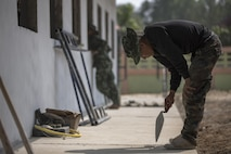 Service members from the United States, Thailand, India, and China build a classroom at the Ban Non Lueam School, Korat Province, Thailand during exercise Cobra Gold, Feb. 13, 2017. Cobra Gold 17 maintains a consistent focus on humanitarian civic action, community engagement, and medical activities conducted during the exercise to support the needs and humanitarian interests of civilian populations around the region. (U.S. Marine Corps Combat Camera photo by Staff Sgt. Nathan O. Sotelo)