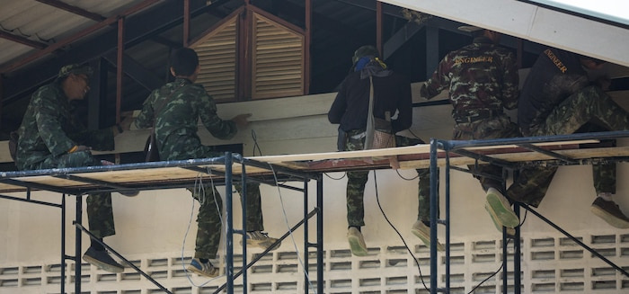 Royal Thai Air Force airmen build a wall at Ban Non Lueam School, Korat Province, Thailand during exercise Cobra Gold, Feb. 13, 2017.  Cobra Gold 17 maintains a consistent focus on humanitarian civic action, community engagement, and medical activities conducted during the exercise to support the needs and humanitarian interests of civilian populations around the region. (U.S. Marine Corps Combat Camera photo by Staff Sgt. Nathan O. Sotelo)