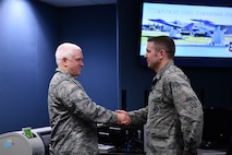 Lt. Gen. L. Scott Rice, Director of the Air National Guard, recognizes Capt. Peter Hickman, 225th Air Defense Squadron, for recently being named a U.S. Air Force Weapons School Top Graduate and First Air Force Command and Control Warrior of the Year.  Rice spent the day visiting two Washington Air National Guard units:  the Western Air Defense Sector at Joint Base Lewis-McChord and the 194th Wing at Camp Murray. (U.S. Air Force photo by Kimberly D. Burke)