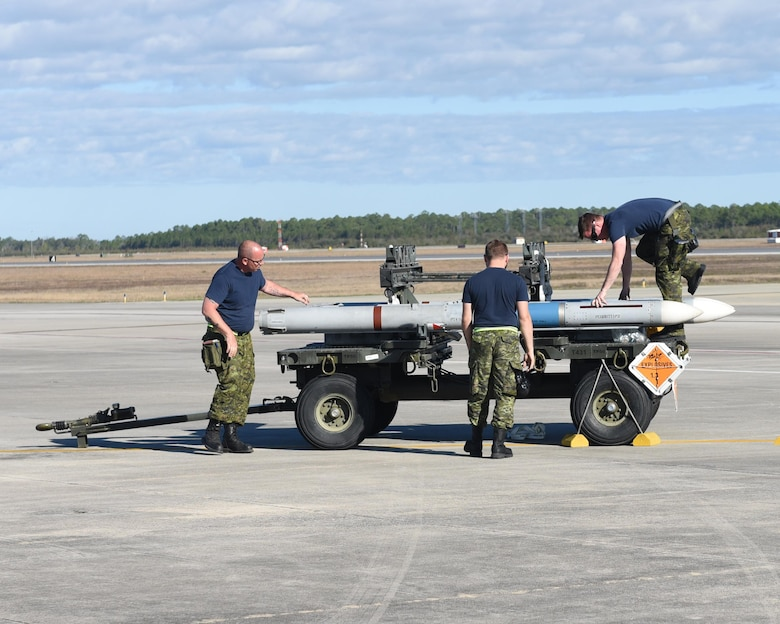 Royal Canadian Air Force weapons systems specialists from the 401st Tactical Fighter Squadron prep training weapons for use during the Weapons Systems Evaluation Program held at Tyndall Air Force Base, Fla., Jan. 31, 2017. The Canadians took part in the exercises Combat Archer and Combat Hammer to test their effectiveness with various weapons tactics and systems. (U.S. Air Force photo by Airman 1st Class Cody R. Miller/Released)