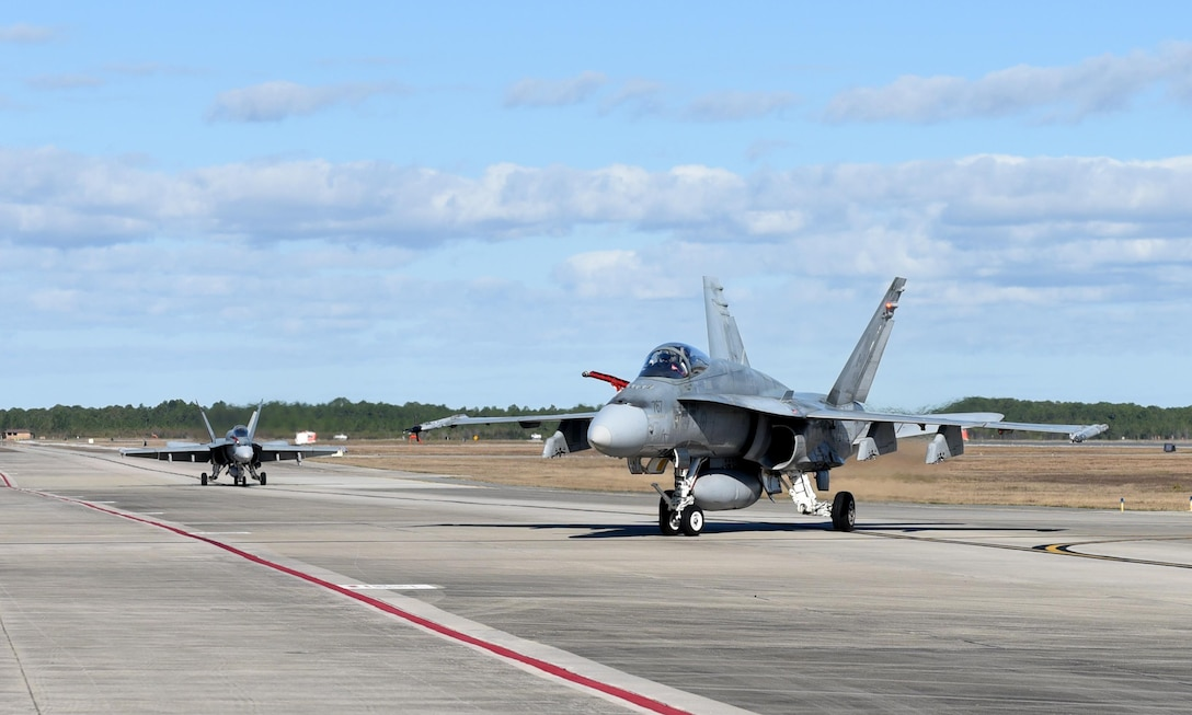 Royal Canadian Air Force CF-18 Hornets finish their flight after taking part in exercise Combat Archer at Tyndall Air Force Base, Fla., Jan. 31, 2017. Both Combat Archer and Combat Hammer are part of the Weapons Systems Evaluation Program operated by the 53rd Weapons Evaluation Group at Tyndall AFB. The program goal is to evaluate a unit's capability to employ a variety of weapons systems throughout all stages of the process, from storage and preparation, to use on a target. (U.S. Air Force photo by Airman 1st Class Cody R. Miller/Released)