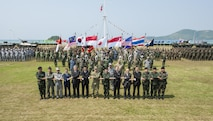 UTAPAO, Thailand (Feb. 14, 2017) – Multi-National Forces officials and representatives pose for a group photo during the official opening ceremony of Cobra Gold 2017. Cobra Gold, in its 36th iteration, is the largest Theater Security Cooperation exercise in the Indo-Asia-Pacific. This year's focus is to advance regional security and ensure effective responses to regional crises by bringing together a robust multinational force to address shared goals and security commitments in the Indo-Asia-Pacific region. (U.S. Navy photo by Mass Communication Specialist 2nd Class Markus Castaneda/Released)