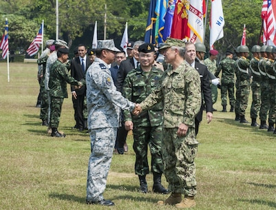 UTAPAO, Thailand (Feb. 14, 2017) – U.S. Pacific Command Commander Adm. Harry Harris shakes hands with Rear Adm. Chanint Phadungkiat, commandant of Amphibious and Combat Support Service Squadron, Royal Thai Fleet during the official opening ceremony of Cobra Gold 2017. Cobra Gold, in its 36th iteration, is the largest Theater Security Cooperation exercise in the Indo-Asia-Pacific. This year's focus is to advance regional security and ensure effective responses to regional crises by bringing together a robust multinational force to address shared goals and security commitments in the Indo-Asia-Pacific region. (U.S. Navy photo by Mass Communication Specialist 2nd Class Markus Castaneda/Released)