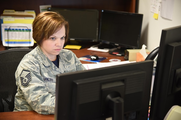 Master Sgt. Bridget VanLiere, 114th Force Support Squadron installation personnel readiness, is the key Airman in the 114th Force Support Squadron that ensures Airmen are prepared for the Reserve Component Period (RCP) deployment and future deployments for the 114th Fighter Wing. Her role is to to ensure all required training and CBTs (computer-based training) are accomplished, member has all required equipment and uniforms, all medical requirements are met and orders are complete in a timely manner. (Air National Guard photo by Staff Sgt. Duane Duimstra/Released)