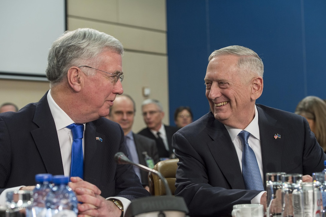 Defense Secretary Jim Mattis talks with Britain's Defense Secretary Michael Fallon during a North Atlantic Council meeting at NATO headquarters in Brussels, Feb. 15, 2017. DoD photo by Air Force Tech. Sgt. Brigitte N. Brantley