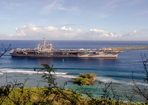 The Nimitz-class aircraft carrier USS Carl Vinson (CVN 70) pulls into Naval Base Guam,  Feb. 10. Vinson is on a regularly scheduled Western Pacific deployment with the Carl Vinson Carrier Strike Group as part of the U.S. Pacific Fleet-led initiative to extend the command and control functions of the U.S. 3rd Fleet in the Indo-Asia-Pacific region. Navy aircraft carrier strike groups have patrolled the Indo-Asia-Pacific regularly and routinely for more than 70 years.
