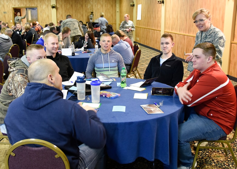 Chief Master Sgt. Jennifer Reecy, 114th HQ, conducts 4-Lenses training for a Yellow Ribbon Reintigration event at the Ramkota Hotel in Sioux Falls, S.D., Feb. 4, 2017. The YRRP is a Department of Defense-wide effort to promote the well-being of National Guard and Reserve members, their families and communities, by connecting them with local resources before, during, and after deployments.(U.S. Air National Guard photo by Staff Sgt. Luke Olson/Released)