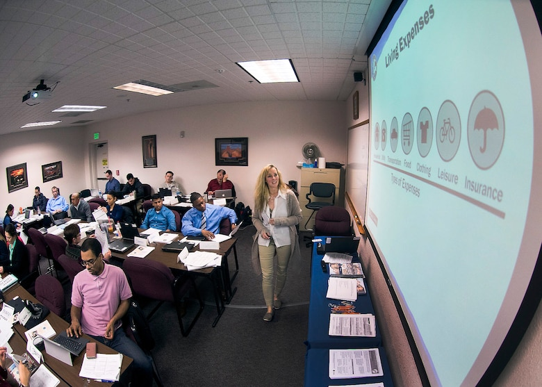 Bonnie Morrow, 60th Force Support Squadron community readiness counselor, teaches a financial management course to service members in  the Transition Assistance Program at Travis Air Force Base, Calif., Feb. 7, 2017. The class is designed to assist military members with the transition from military service to civilian life. (US Air Force  photo/T.C. Perkins Jr.)