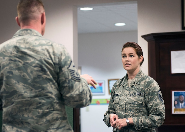 A first sergeant confers with Master Sgt. Erine Gallant, 60th Force Support Squadron Airman and Family Readiness Center superintendent, about a new policy and how it will affect his Airmen during a discussion at the A&FRC at Travis Air Force Base, Calif., Feb. 7, 2017. The A&FRC serves as a focal point for service members and their families to find information on various topics including professional development, financial counseling and employment opportunities. (US Air Force  photo/T.C. Perkins Jr.)