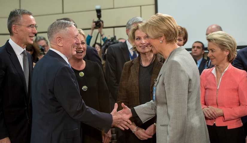 Defense Secretary Jim Mattis greets Italian Defense Minister Roberta Pinotti before a North Atlantic Council meeting at NATO headquarters in Brussels, Feb. 15, 2017. DoD photo by Air Force Tech. Sgt. Brigitte N. Brantley