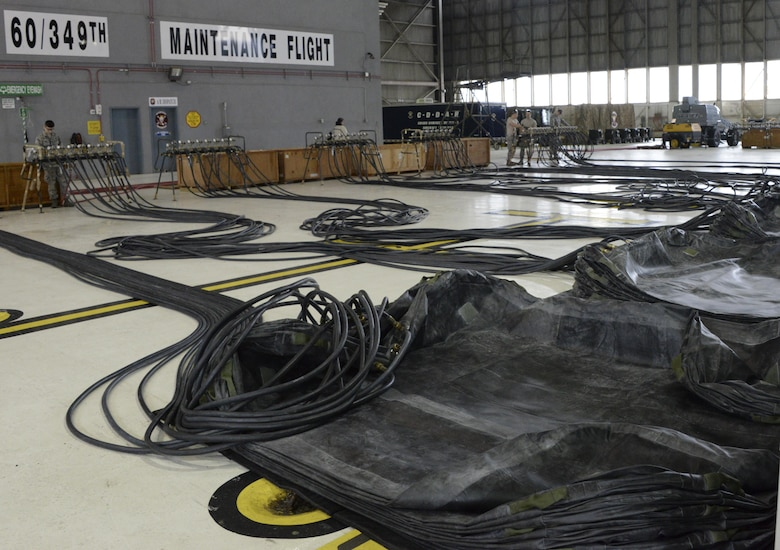 The 60th Maintenance Squadron sets up for the annual quality assurance inspection of the crash, damaged or disabled aircraft recovery program Feb. 9, 2017 at Travis Air Force Base, Calif. The lifting bags, capable of supporting up to 52,000 pounds individually, are used to lift a downed aircraft so it can be salvaged, repaired and recovered.  (U.S. Air Force photo by Senior Airman Amber Carter)