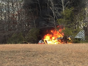 North Carolina Army National Guard Sgt. Charles Roper pulled the pilot from the burning cockpit. Roper saw the plane crash and immediately put his truck into 4WD, driving through ditches and farmland to get to the crash site.