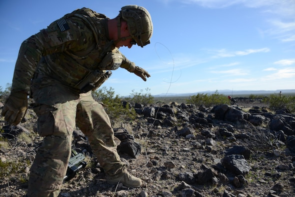 Staff Sgt. Timothy Doland, 56th Civil Engineer Squadron explosive ordnance disposal team leader, remotely moves an object covering roadside bomb during a contingency problem Feb. 8, 2017, at the Barry M. Goldwater Range in Gila Bend, Az.  EOD Airmen remotely move possible roadside bomb threats from a safe distance to avoid potential blasts. (U.S. Air Force photo by Airman 1st Class Alexander Cook)