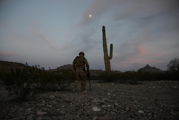 Staff Sgt. Timothy Doland, 56th Civil Engineer Squadron explosive ordnance disposal team leader, sweeps the area for possible roadside bombs during a contingency problem Feb. 8, 2017, at the Barry M. Goldwater Range in Gila Bend, Az. EOD Airmen use their equipment, along with their senses, to locate possible threats in the surrounding area. (U.S. Air Force photo by Airman 1st Class Alexander Cook)