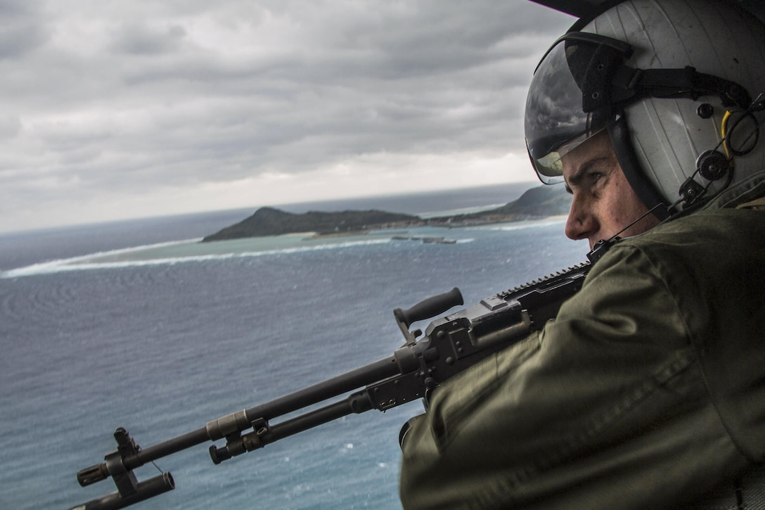 Marine Corps Lance Cpl. Derek Edwards participates in tactical air control off the coast of Okinawa, Japan, Feb. 9, 2017. The training focused on enhancing efficiency between air and ground elements, which is crucial to maintain a stronger, more capable forward-deployed force of readiness to support the U.S.-Japan alliance and U.S. regional partners. Edwards is a crew chief assigned to Marine Light Attack Helicopter Squadron 267, 3rd Marine Aircraft Wing. Marine Corps photo by Lance Cpl. Brooke Deiters