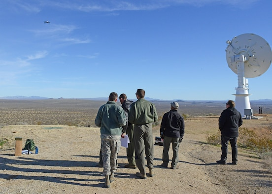 Members of the Emerging Technologies Combined Test Force conducted the first test for the CTF Feb. 13. The test was conducted for the 412th Range Squadron, which came up with the idea of using a small unmanned aerial system to calibrate telemetry antennas (right). (U.S. Air Force photo by Kenji Thuloweit)