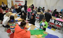 Teachers, U.S. Army Soldier volunteers, family members and students work to build gliders during the Family science, technology, engineering and mathematics Night event at Joint Base Langley-Eustis, Va., Feb. 9, 2017. Soldiers and teachers worked with children to demonstrate how engineering and design play important roles in future careers and education goals. (U.S. Air Force photo by Staff Sgt. Teresa J. Cleveland)