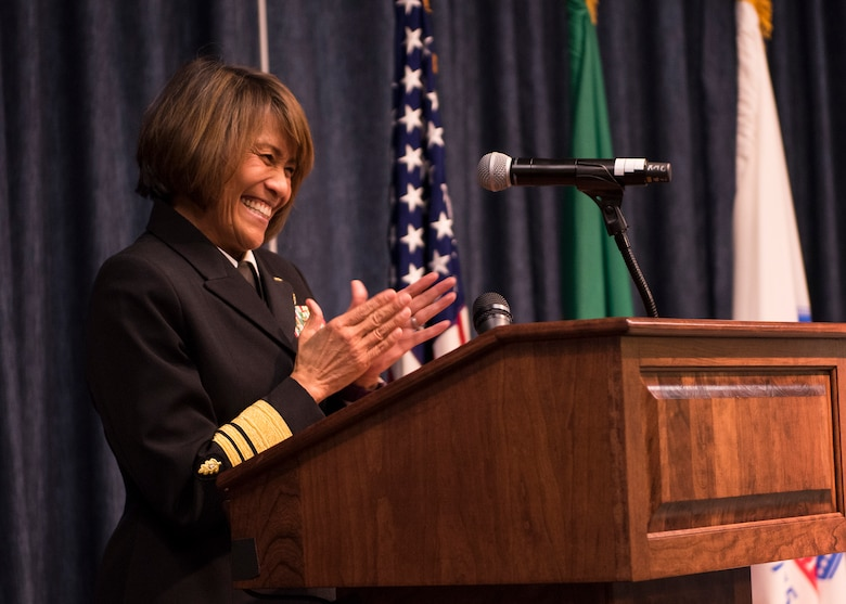 Navy Vice Admiral Raquel Bono, Defense Health Agency director, applauds Col. Meg Carey after congratulating the her efforts in implementing the MHS Genesis system Feb. 15, 2017, at Fairchild Air Force Base, Wash. Fairchild was selected to be the pilot base for the Genesis due to its location, patient load, a record of excellence and enthusiasm to take on the project. (U.S. Air Force photo/Airman 1st Class Ryan Lackey)