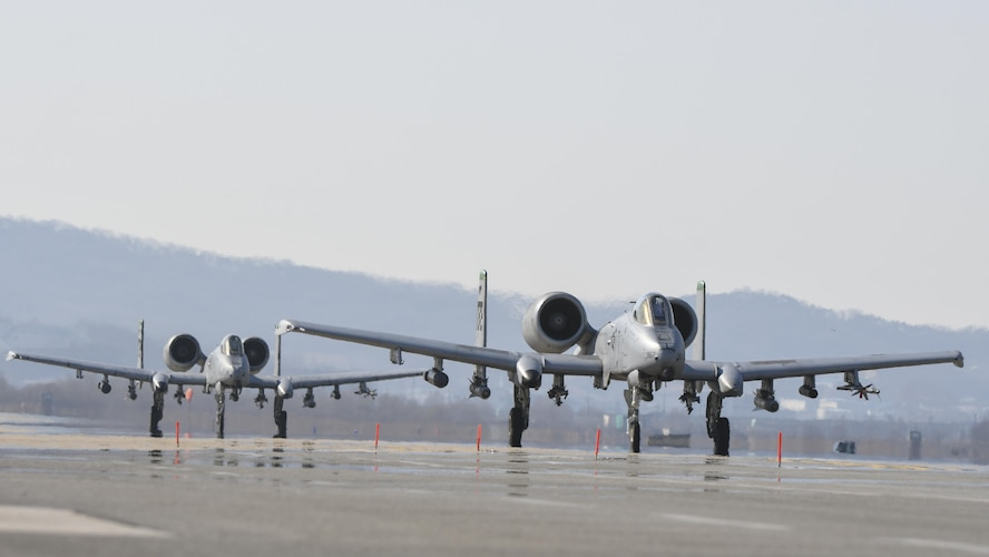 Two A-10 Thunderbolts assigned to the 25th Fighter Squadron taxi out to the runway during Buddy Wing 17-3 at Osan Air Base, Republic of Korea, Feb. 14, 2017. During Buddy Wing 17-3, pilots from the 25th FS and the ROK air force 237th Tactical Control Squadron flew training missions to increase to the two units' ability to work together in a wartime scenario. (U.S. Air Force photo by Staff Sgt. Victor J. Caputo)