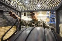 Senior Airman Nicolas Mares, 305th Maintenance Squadron wheel and tire technician, prepares to fill a C-17 Globemaster III front tire at Joint Base McGuire-Dix-Lakehurst, New Jersey, Feb. 15, 2017. The technicians recently began utilizing a new tire filling station which has cut the amount of time required to fill tires in half.