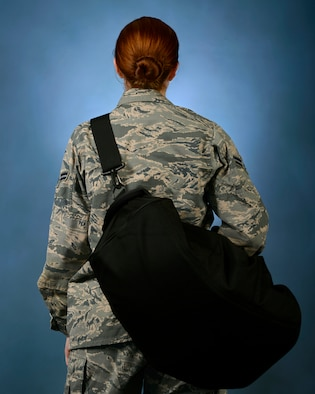 Air Force Instruction 36-2903, Dress and Personal Appearance of Air Force Personnel, was updated to include new uniform authorizations, such as the use of gym bag shoulder straps, Feb. 9, 2017. It is the responsibility of all Airmen to stay informed of instruction changes as they are constantly evolving. (U.S. Air Force illustration by Airman 1st Class Kathryn R.C. Reaves)
