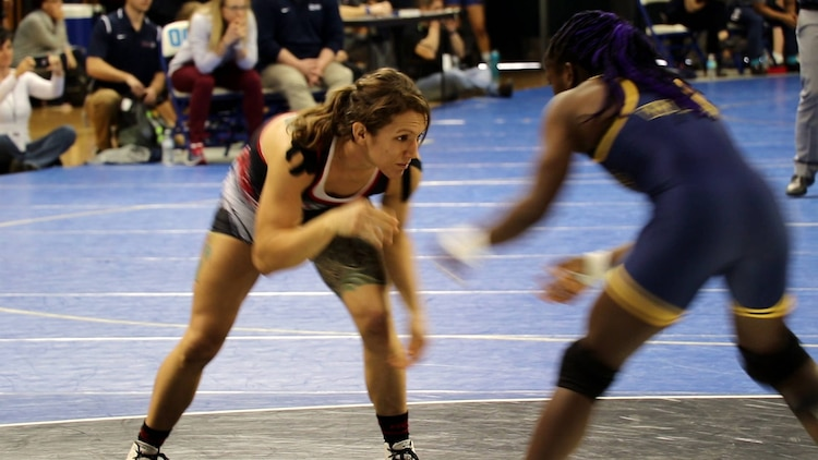 Marine veteran, Kalyn Schwartz, wrestled for Southern Oregon University in the 123-pound weight class, Feb. 10-11, at the Women's Collegiate Wrestling Association National Championships in Oklahoma City. While in the Marine Corps, Schwartz's military specialty occupation was aircraft rescue and firefighting. (U.S. Marine Corps photo by Cpl. Jennifer Webster/Released)