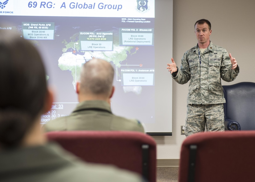 Maj. Zachary Garrett, a 49th Medical Group aerospace and operational physiologist, briefs personnel about the stress and sleep hygiene during Top Knife, Feb. 9, 2017 at Holloman Air Force Base, N.M. During Top Knife, flight surgeons, physiologists, psychologists and chaplains from across the Air Force came to Holloman and were taught about the current challenges facing RPA personnel. (U.S. Air Force photo by Senior Airman Emily Kenney)