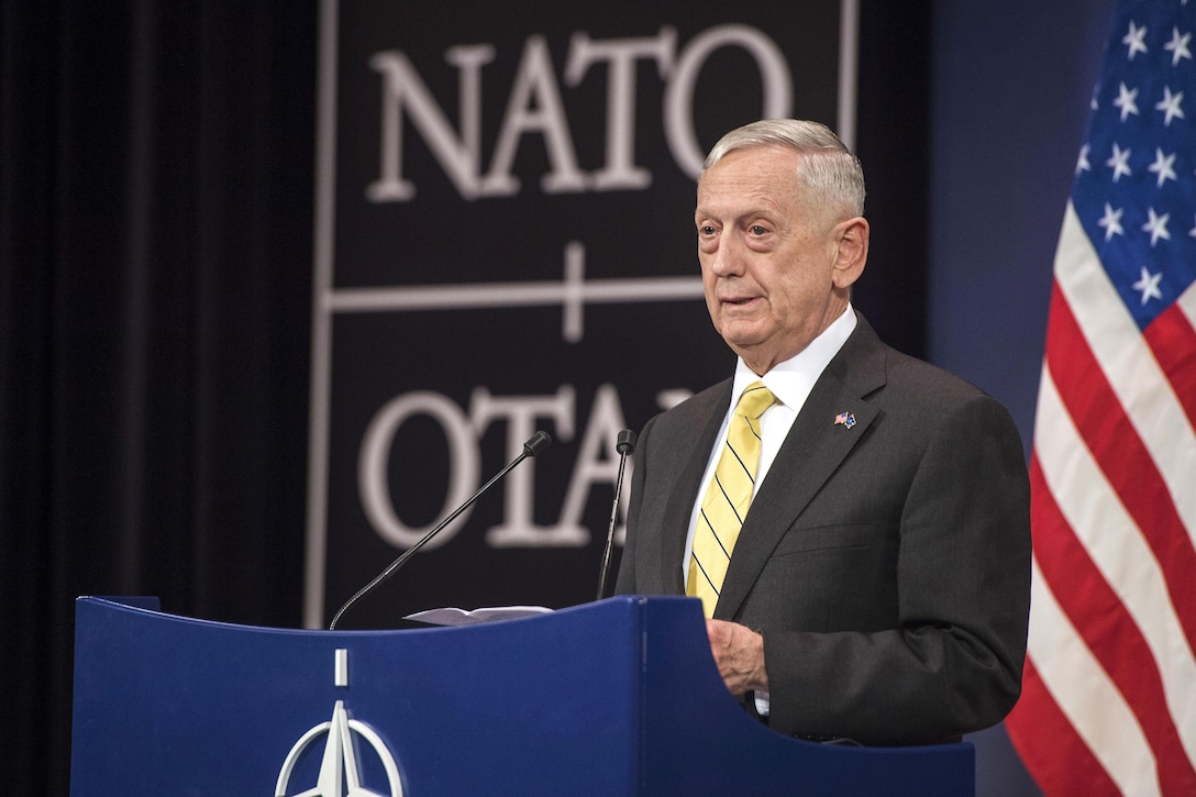 Defense Secretary Jim Mattis speaks at a press conference at NATO headquarters.