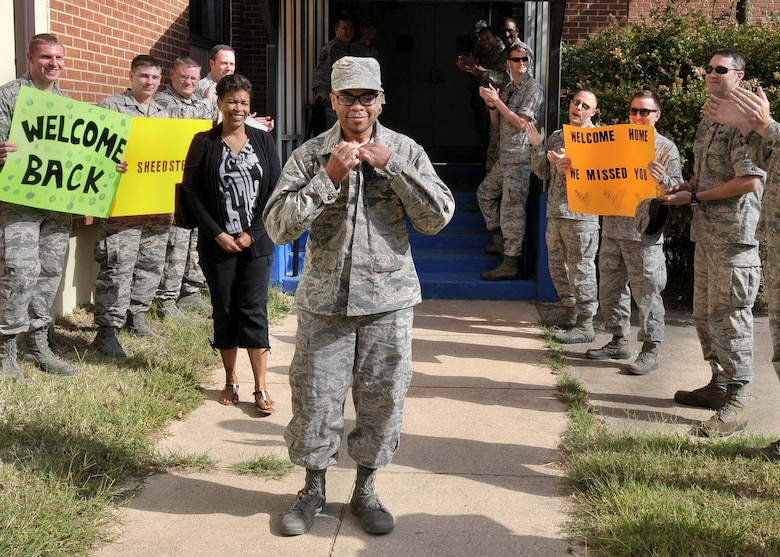 Staff Sgt. Rasheed, 7th Intelligence Squadron, is greeted by Airmen from the 7th IS during a welcome back celebration Sep. 16, 2016, at Fort George G. Meade, Maryland. Rasheed suffered a cerebral aneurysm in 2015 and is currently working to return to his career field as an intelligence analyst. (U.S. Air Force photo/Tech. Sgt. Veronica Pierce)