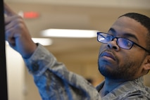 Staff Sgt. Rasheed, 7th Intelligence Squadron, selects the letter corresponding to the word spoken from a touch screen interactive program which tests his cognitive reaction time during occupational therapy Jan. 17. Rasheed suffered a cerebral aneurysm in 2015. (U.S. Air Force photo/Staff Sgt. Alexandre Montes)