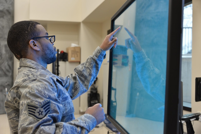 Staff Sgt. Rasheed, 7th Intelligence Squadron, selects a letter corresponding to a word spoken from a touch screen interactive program which tests his cognitive reaction time during occupational therapy Jan. 17. Rasheed suffered a cerebral aneurysm in 2015 and part of his recovery is working on occupational exercises. (U.S. Air Force photo/Staff Sgt. Alexandre Montes)