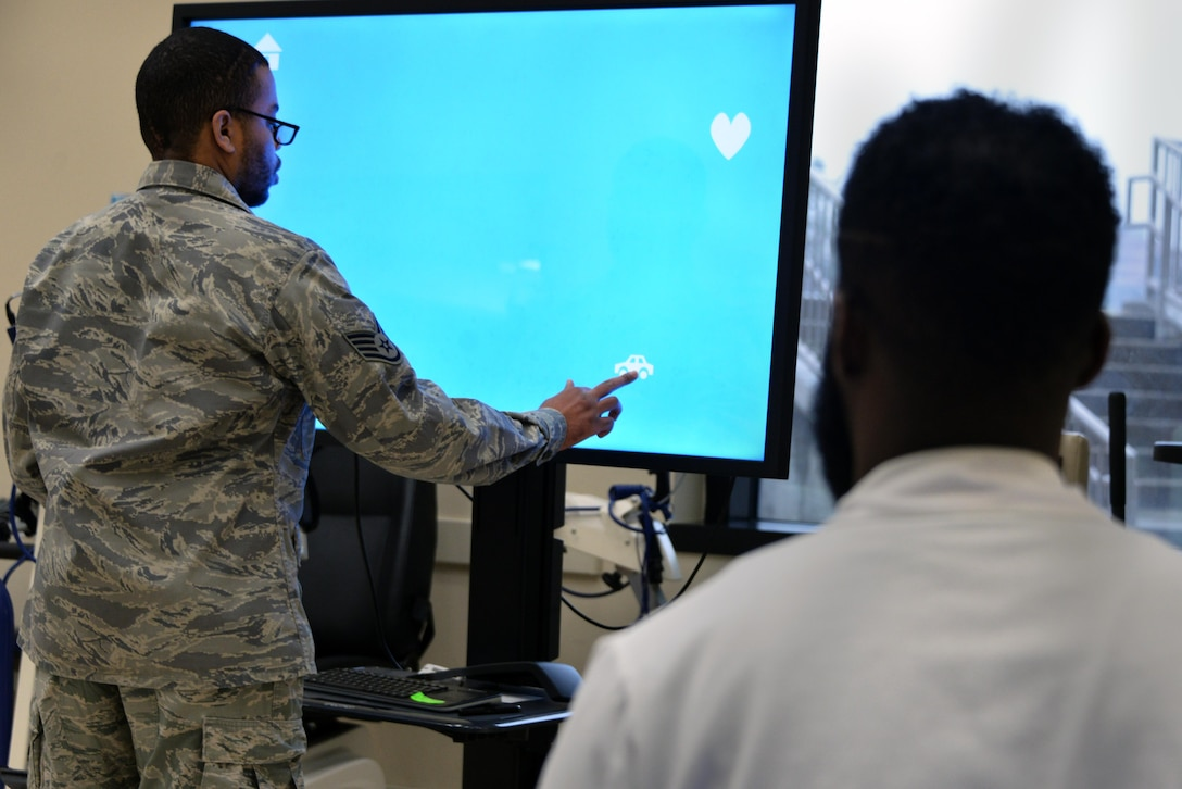 Staff Sgt. Rasheed, 7th Intelligence Squadron, selects the shape corresponding to the word spoken from a touch screen interactive program which tests his cognitive reaction time during occupational therapy Jan. 17. Rasheed suffered a cerebral aneurysm in 2015. (U.S. Air Force photo/Staff Sgt. Alexandre Montes)