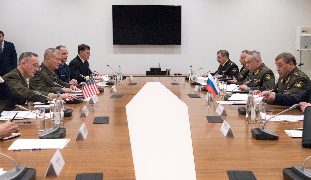 Marine Corps Gen. Joseph F. Dunford Jr., chairman of the Joint Chiefs of Staff, speaks with Gen. Valery Gerasimov, chief of the General Staff of the Armed Forces of Russia, during a bilateral meeting at the Heydar Aliyev Center in Baku, Azerbaijan Feb. 16, 2017. The meeting between Dunford and Gerasimov is designed to enhance senior mil-to-mil communication between the United States and Russia. (Dept. of Defense photo by Navy Petty Officer 2nd Class Dominique A. Pineiro/Released)