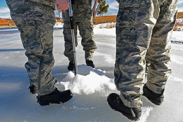Airmen from the 28th Civil Engineer Squadron use different tools, such as a sledge pole, auger and survey equipment to gather information from water levels of a lake at Prairie Ridge golf course, in Box Elder, S.D., Feb. 14, 2017. The Airmen used this opportunity to not only complete a project, but also acquire proficiency with each piece of equipment used. (U.S. Air Force photo by Senior Airman James L. Miller)