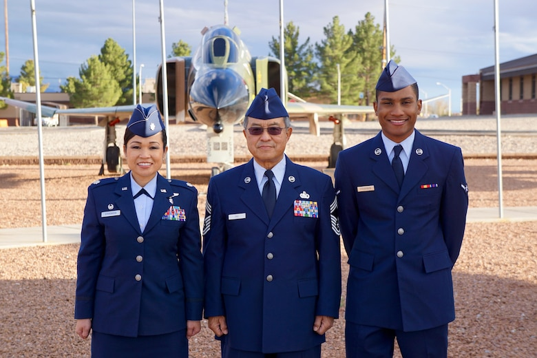 Lt. Col. Bonnie Stevenson, 49th Medical Operations Squadron commander, poses with her father, Chief Master Sergeant (Ret.) Bill Eng, and her son, Airman Darrius Stevenson. Airman Stevenson graduated from Air Force Basic Military Training at Lackland Air Force Base on Dec. 9, 2016. Airman Stevenson is currently receiving his Cyber Space Operation training at Keesler Air Force Base. (Photo courtesy of Lt. Col. Bonnie Stevenson)