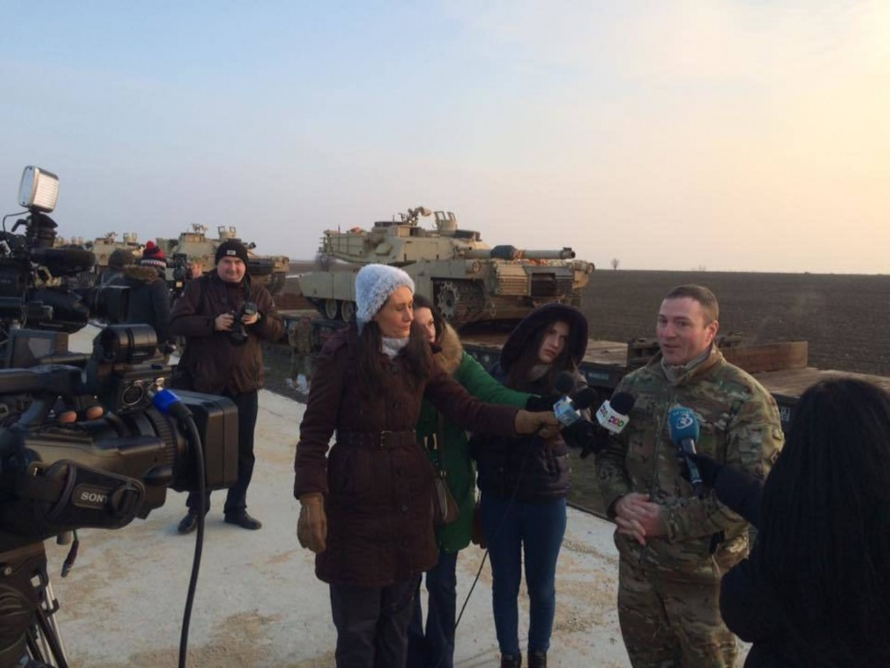 Army Maj. Scott Stephens, executive officer, 1st Battalion, 8th Infantry Regiment, fields questions from Romanian journalists at the arrival of the first 15 tanks to Mihail Kogalniceanu Airbase, Romania, Feb. 14, 2014. The arrival of the tanks and roughly 500 soldiers from 1st Battalion, 8th Infantry Regiment, marks the beginning of a continuous rotation of U.S. troops in southeastern Europe as part of Operation Atlantic Resolve. Army photo by 2nd Lt. Gunbold Ligden