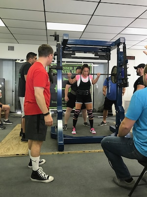 U.S. Army Sergeant First Class (SFC) Jennifer Palacios performs a squat during in the American Powerlifting Association (APA) Thunder Bay Throwdown. Palacios broke the Florida state squat record in the Raw Sub Master (33-39) age division by lifting 230lbs. (Courtesy photo)